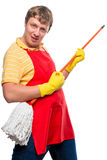 Jolly man in a red apron with a mop Royalty Free Stock Images