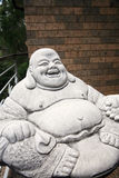 Jolly monk statue. With large belly Royalty Free Stock Image