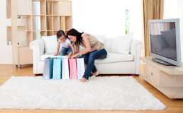 Jolly mother and her daughter after shopping Stock Image