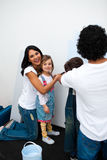 Jolly parents with their children painting a room Royalty Free Stock Photos