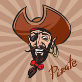 Jolly Pirate cartoon head in a hat Stock Images