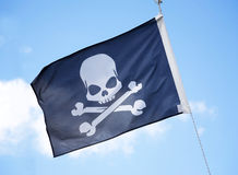 The Jolly Roger. Flag on pirate Stock Images