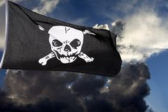 Jolly Roger against storm clouds Stock Photo