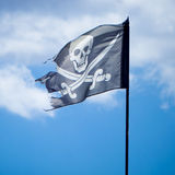 The jolly roger. On a cloudy sky Stock Image