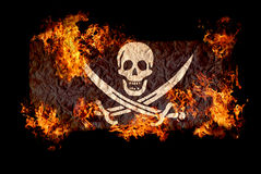 Jolly Roger in fire. Stock Image