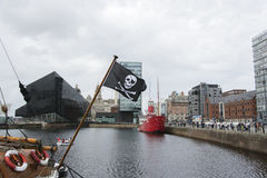 Jolly Roger flying over Liverpool Stock Image