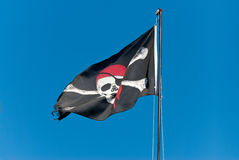 Jolly Roger. The pirate flag waving proudly Royalty Free Stock Photos