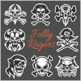 Jolly Roger symbols - vector set on dark background. Pirates skulls and Captain skeleton in bandana or tricorne hat with Royalty Free Stock Images