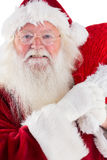 Jolly Santa carries his sack Stock Image