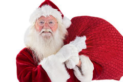 Jolly Santa carries his sack Royalty Free Stock Images