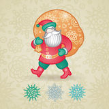 Jolly Santa Claus with a bag of gifts and snowflakes. Royalty Free Stock Images