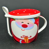 Jolly Santa Claus ceramic cup with cover and spoon Stock Photos