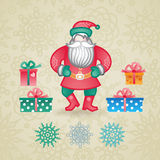 Jolly Santa Claus with a gifts and snowflakes. Royalty Free Stock Photos