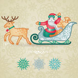 Jolly Santa Claus in a sleigh with a sacks of gift. Stock Image