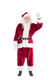 Jolly Santa waving at camera Stock Images