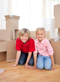 Jolly sibling while moving house Stock Images