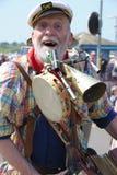 Jolly street musician Royalty Free Stock Image