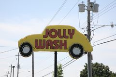 Jolly Wash. A car wash shop where automobiles are washed and detailed by hand without the use of equipment or automated machines Stock Photo