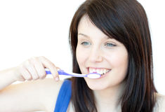 Jolly woman brushing her teeth Stock Photos