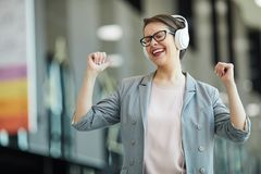 Jolly woman dancing in excitement royalty free stock image