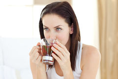 Jolly woman drinking tea Royalty Free Stock Image