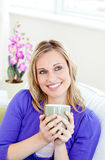 Jolly woman enjoying her coffee Stock Photo