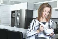 Jolly woman having breakfast at home Royalty Free Stock Photography