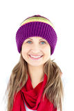 Jolly woman smiling and wearing cap and red scarf Stock Photo