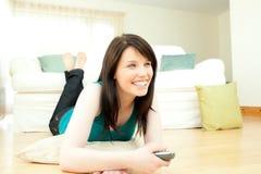 Jolly woman watching television Royalty Free Stock Photos