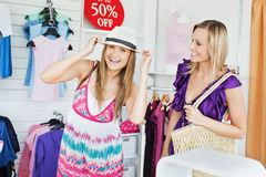 Jolly women choosing clothes together Stock Image