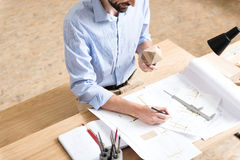 Jolly woodworker with beard creating design of new manufacture indoor Royalty Free Stock Image