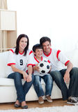 Jolly Young Family Watching A Football Match Royalty Free Stock Image