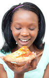 Jolly young woman eating a pizza Stock Photos