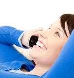 Jolly young woman talking on phone royalty free stock photography