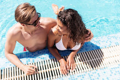 Jolly youthful man and woman enjoying their rest in water Stock Photos