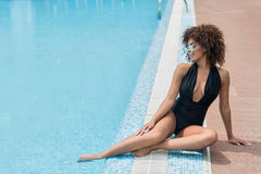 Jolly youthful mulatto girl having rest during summer vacation Royalty Free Stock Images