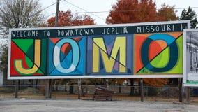 JOMO Welcome tecken, Joplin, MO royaltyfria foton
