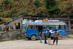 Jomsom, Nepal - October 19: People having a rest from bus ride, on October 19 2015 in Jomsom, Nepal. Royalty Free Stock Image