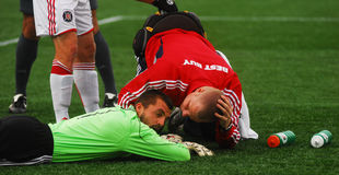 Jon Busch, Chicago Fire Goal Keeper. Chicago Fire Goalkeeper is checked for an injury by the Fire training staff stock images