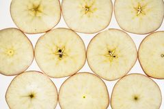 Jonagold apple malus domestica slices. Jonagold apple cut in slices Royalty Free Stock Images