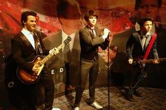 Jonas Brothers Wax Figures royaltyfri bild