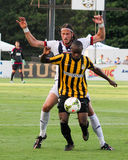 Jonass Olsson and Emmanuel Adjetey battle for the ball. Royalty Free Stock Photography