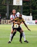 Jonass Olsson and Emmanuel Adjetey battle for the ball. Stock Photos