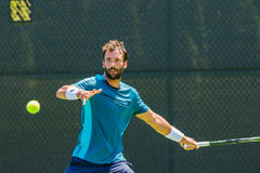Jonathan Eysseric plays in qualifer at the Winston-Salem Open stock photos