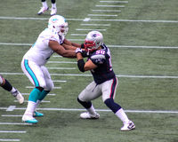 Jonathan Martin defending against Rob Ninkovich Stock Photography