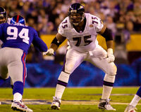 Jonathan Ogden, Baltimore Ravens left tackle. Left tackle Jonathan Ogden of the Baltimore Ravens blocks oncoming New York Giants defensive playerin Super Bowl Royalty Free Stock Photo