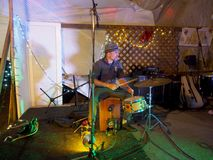 Jonathan of Taimane and band playing drums at Optimysstique Royalty Free Stock Photo