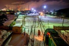 Jonava Achema factory. Near Achema factory train at night Lithuania stock photography