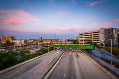 The Jones Falls Expressway at sunset, seen from the Howard Street Bridge, in Baltimore, Maryland. stock photos