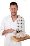 Jong aantrekkelijk chef-kok Kaukasisch mannetje, kip Stock Foto